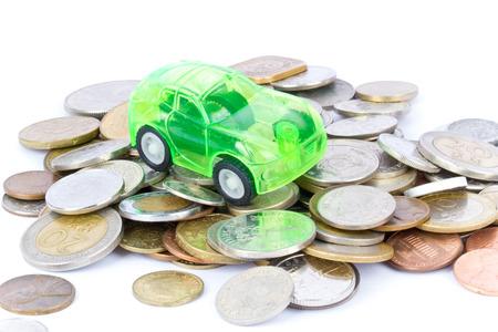 Spielzeugauto auf Münzen Standard-Bild - 26547362