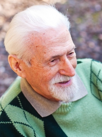 the grandfather: Portrait of an elderly man in the outdoors