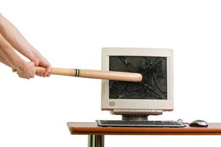 Breaking in a monitor with a baseball bat, isolated on white. photo
