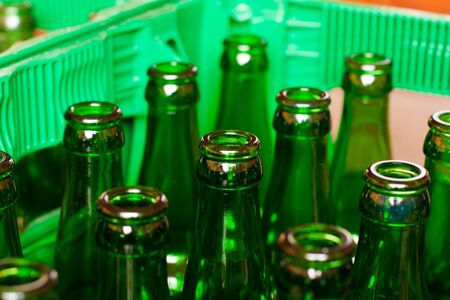 A crate of empty beer bottles. photo