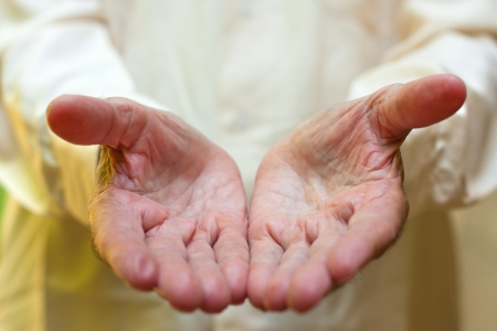 The concept of giving - Elderly mans hands. photo