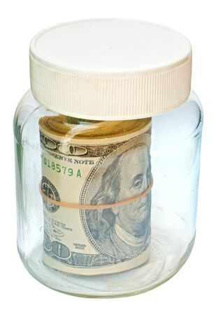 American dollars rolled up and placed in a jar. photo