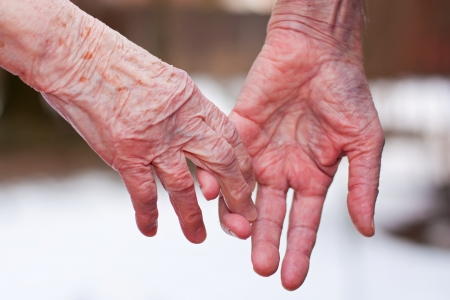 parting: Hands of an elderly couple, close-up. Stock Photo
