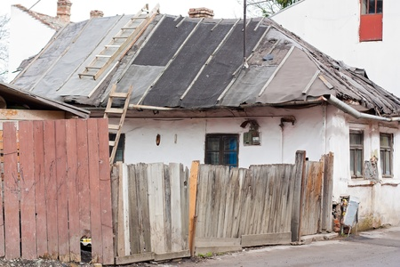 decrepitude: An old broken-down house falling apart