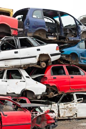 junkyard: Piled up destroyed cars in the junkyard.