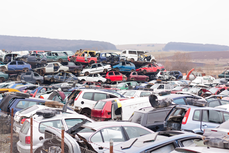 salvage yards: Piled up destroyed cars in the junkyard.