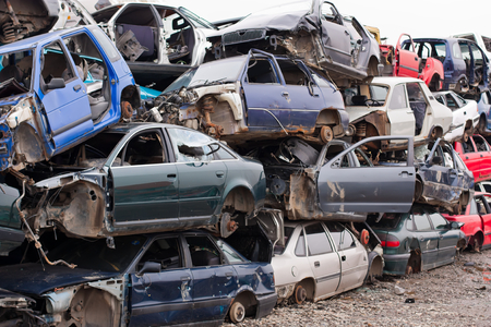 junk car: Piled up destroyed cars in the junkyard.