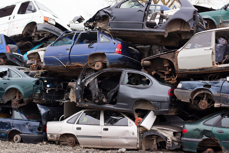 junk yard: Piled up destroyed cars in the junkyard.