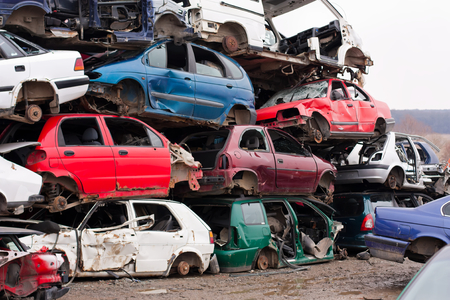 abandoned car: Piled up destroyed cars in the junkyard.