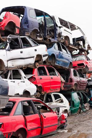 junk car: Piled up destroyed cars in the junkyard.