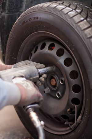 automobile repair shop: Changing the wheels in an automobile repair shop.