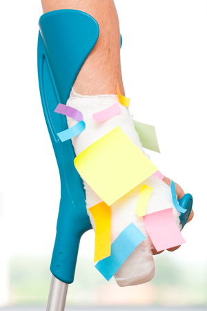 assistive: Multiple blank sticky notes on a bandaged hand. Stock Photo