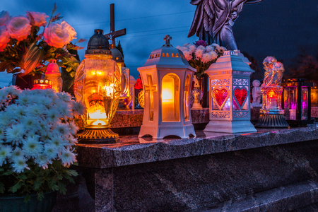 Colorful candles on the cemetery at All Saints Day, Poland Stock fotó - 92473308