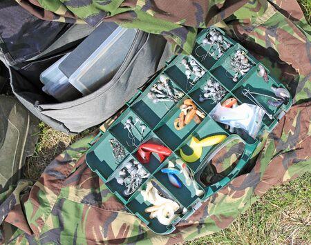 Fishing equipment on grass 写真素材
