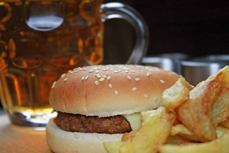 Hamburger with fries and cold beer.