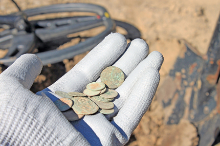 Search for treasure using a metal detector Stock Photo