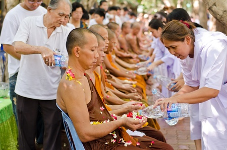 NONTHABURI THAILAND-APRIL13:people celebrate Songkran (new year  water festival: 13 April) by pouring water to buddhist priest and asked for blessings on Songkran festival in temple,Nonthaburi,Thailand