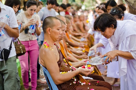 nonthaburi: NONTHABURI THAILAND-APRIL13:people celebrate Songkran (new year  water festival: 13 April) by pouring water to buddhist priest and asked for blessings on Songkran festival in temple,Nonthaburi,Thailand