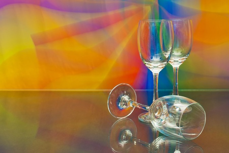 empty wine glass against colourful background photo