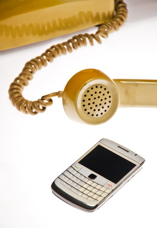 Antique and mobile phones in white background photo