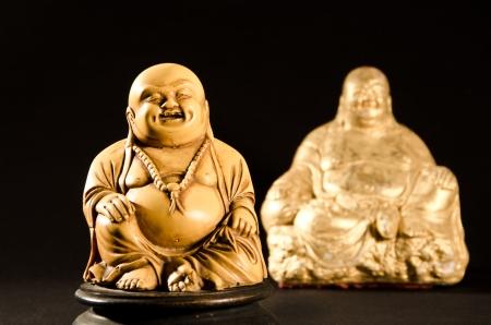 Smiling Buddha  God of Happiness isolated on black background  photo