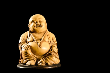 Smiling Buddha  God of Happiness isolated on black background  photo
