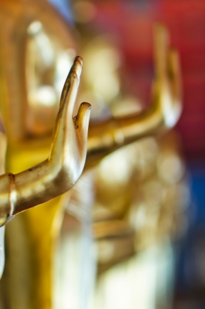 Buddha golden statue blessing hand, Wat Pho, Thailand photo