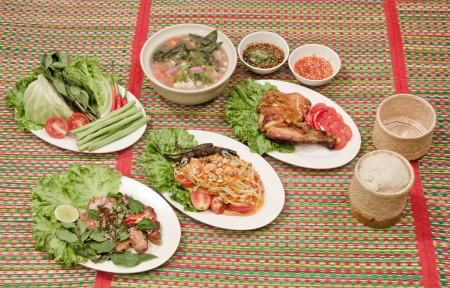 Somtum   Northeast Thai style food on mat Stock Photo - 13624035