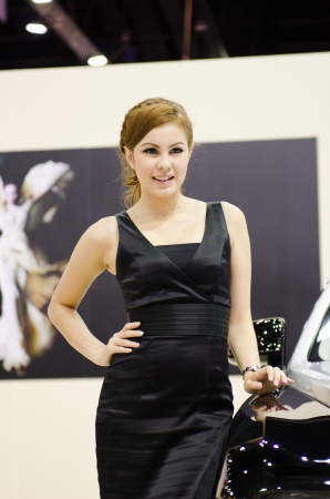BANGKOK, THAILAND - April 6: An unidentified female presenter at Rolls Royce booth in the 33th Thailand International Motor Expo 2012 at IMPACT on April 6, 2012 in Bangkok, Thailand.