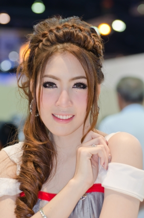BANGKOK, THAILAND - April 6: An unidentified female presenter at Nissan booth in the 33th Thailand International Motor Expo 2012 at IMPACT on April 6, 2012 in Bangkok, Thailand.