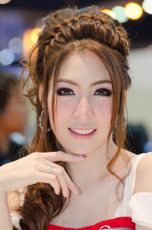 BANGKOK, THAILAND - April 6: An unidentified female presenter at Nissan booth in the 33th Thailand International Motor Expo 2012 at IMPACT on April 6, 2012 in Bangkok, Thailand. Stock Photo - 13685048