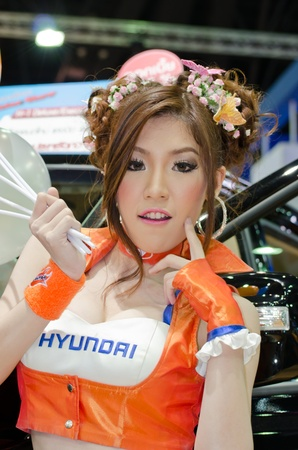 BANGKOK, THAILAND - April 6: An unidentified female presenter at Hyundai booth in the 33th Thailand International Motor Expo 2012 at IMPACT on April 6, 2012 in Bangkok, Thailand. Stock Photo - 13685054