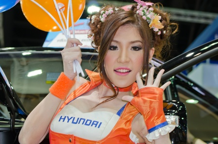 BANGKOK, THAILAND - April 6: An unidentified female presenter at Hyundai booth in the 33th Thailand International Motor Expo 2012 at IMPACT on April 6, 2012 in Bangkok, Thailand.