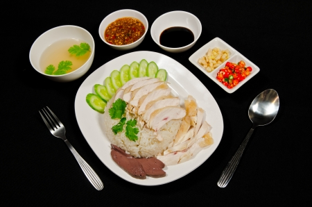 Thai gourmet steamed chicken with rice in black background photo