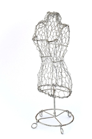 Mannequin made of wire on white background photo