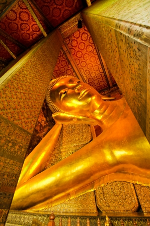 Reclining golden Buddha, Wat Pho, Bangkok, Thailand photo