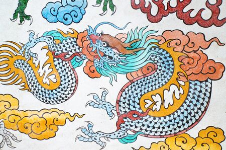 colorful chinese dragon at the wall of temple, Thailand   No any trademark or restrict matter in this photo