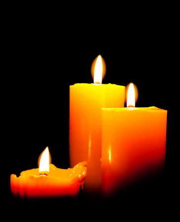 burning candles in front of black background photo