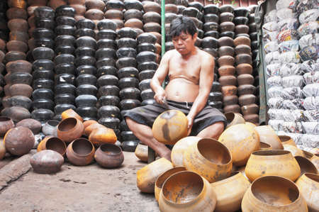 BANGKOK, THAILAND - September 26:  An unidentified man make Bat (The alms bowl used by monks to receive donations of foods in the morning)  on September  26, 2011 at Ban Bat Community, Bangkok,Thailand. Editorial