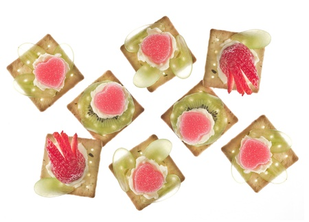 Canapes with grape, strawberry, jelly and creme fraiche against a white background  Stock Photo