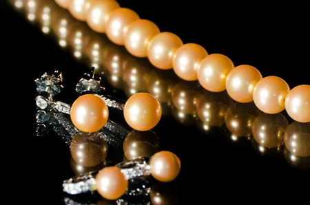 luxury jewellery pearl set  necklace and earrings  over black background Stock Photo
