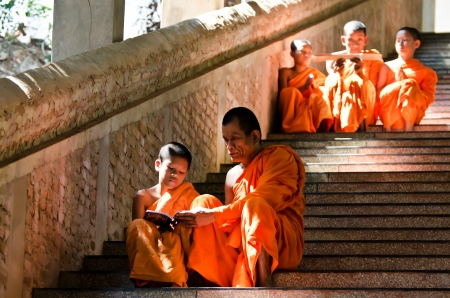 KANCHANABURI THAILAND-January 29:  An unidentified monks  teaching young novice monks in temple  on January 29, 2012  at KANCHANABURI THAILAND. Editorial