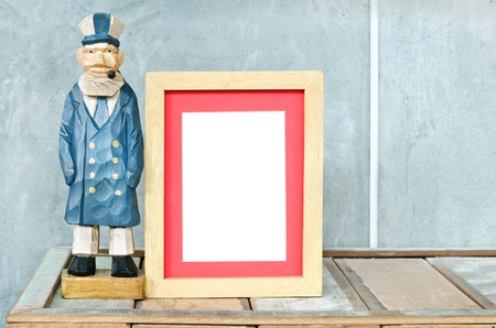 Old sailor toy with wood frame for a picture Stock Photo - 14613031