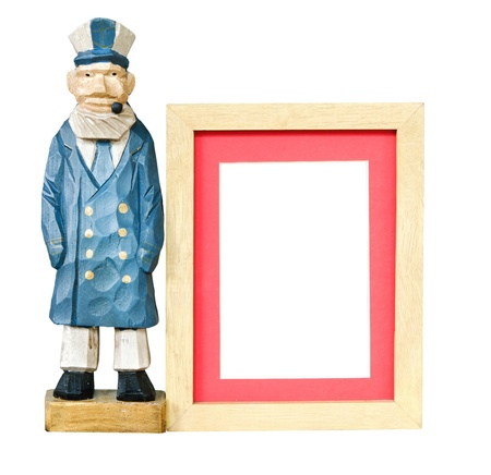 Old sailor toy with wood frame for a picture Stock Photo - 14613029