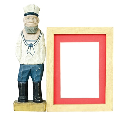 Old sailor toy with wood frame for a picture Stock Photo - 14613028