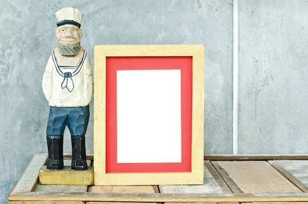 Old sailor toy with wood frame for a picture Stock Photo - 14613032
