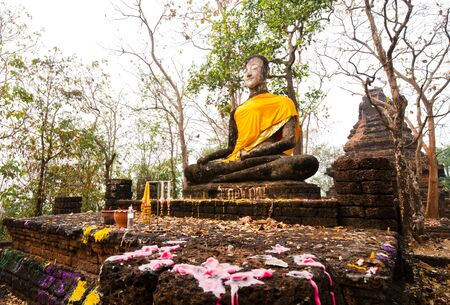 Buddha statue in Sukhothai Historical Park, ancient capital of Thailand  This is traditional and generic style in Thailand  No any trademark or restrict matter in this photo