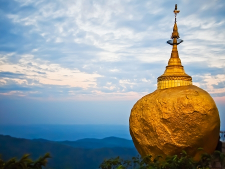 Golden Rock, one of the most sacred buddhist stupa, Kyaiktiyo Pagoda, Myanmar photo