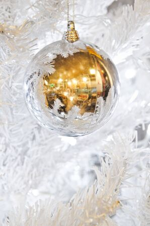 Christmas ball bauble hanging on Christmas tree photo