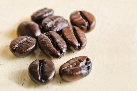 coffee beans on the wooden table. Soft focus.